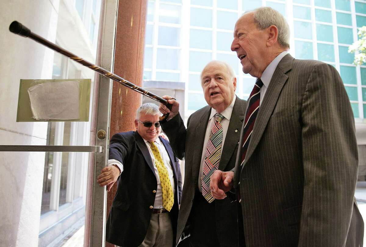 """""""This cane is just for show,"""" Tom Benson jokes as he leaves the New Orleans courthouse for lunch following a morning of testimony in his competency trial Friday."""