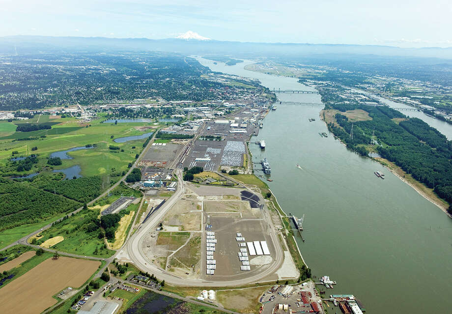 Tesoro Corp., with partner Savage Cos., hopes deliver favorably priced crude oil by rail to the area in the foreground of this aerial photo of the Port of Vancouver USA on the Columbia River, but the project has met with delays. Photo: Port Of Vancouver USA
