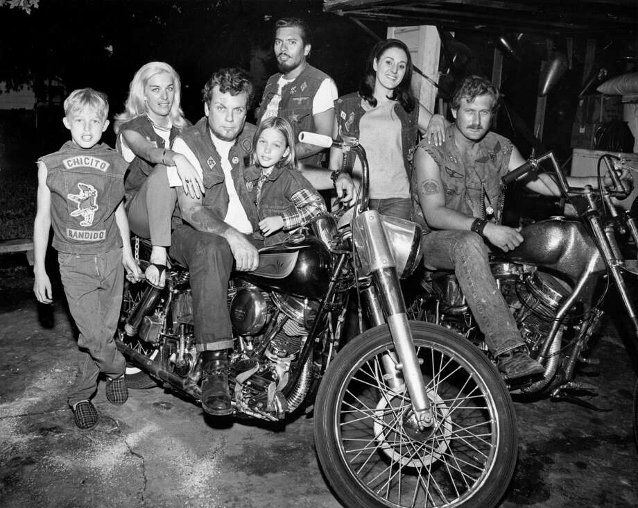 "Bandidos founder Don ""Mother"" Chambers, on the left motorcycle, sits with friends and family in a photograph from 1969.  Photo: Bill Goodwin, HP Staff / Houston Post files"