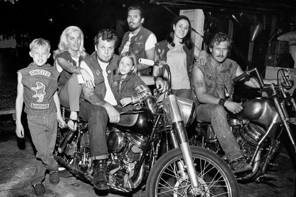 "Bandidos founder Don ""Mother"" Chambers, on the left motorcycle, sits with friends and family in a photograph from 1969. The vests - and the patches that adorn them - are trademarks of the group."