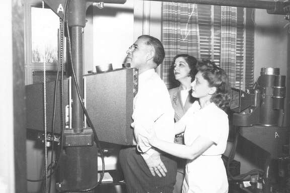 A portable x-ray machine is set up at Alazan-Apache courts in January 1948 where the city health department and other sponsoring agencies expected 20,000 residents of the southwestern section of the city will be given free chest x-ray examination before the machine was moved.