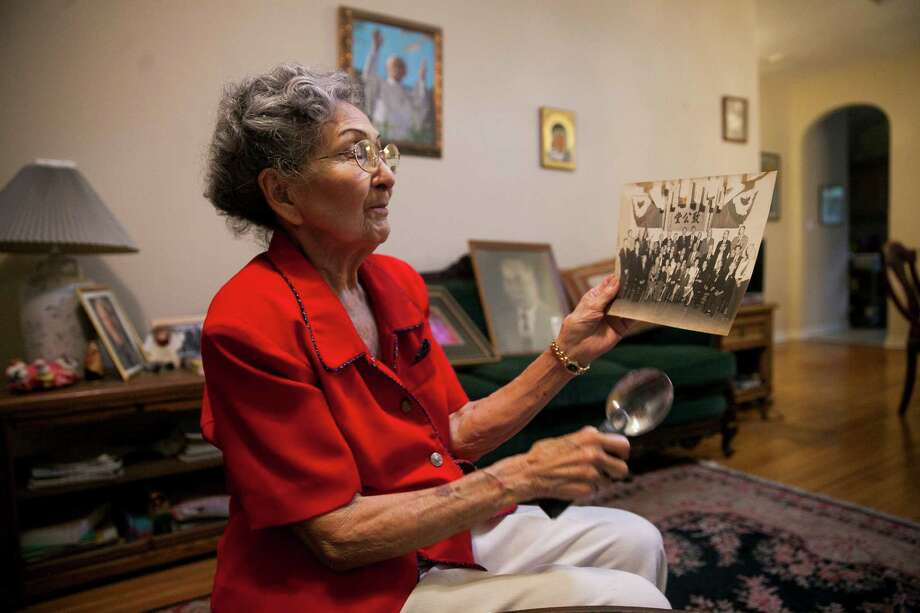 Josefina Kung Dong looks through old photographs of her father Chong Dong, May 13.in her home. Her father migrated from his village in Canton, China, in the 1900s to Veracruz, Mexico. He then worked for Gen. John J. Pershing, along with hundreds of other Chinese that provided his troops with laundering, cooking and other services. After Gen. Pershing returned to the U.S., he brought many Chinese along with Dong through New Mexico and eventually arrived in San Antonio. Photo: Julysa Sosa / For The Express-News / Julysa Sosa For the San Antonio Express-News