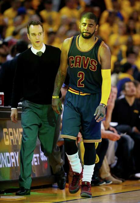 Cleveland guard Kyrie Irving leaves Thursday's game against the Warriors not knowing a knee injury would leave him watching the Finals. Photo: Ezra Shaw, Staff / 2015 Getty Images