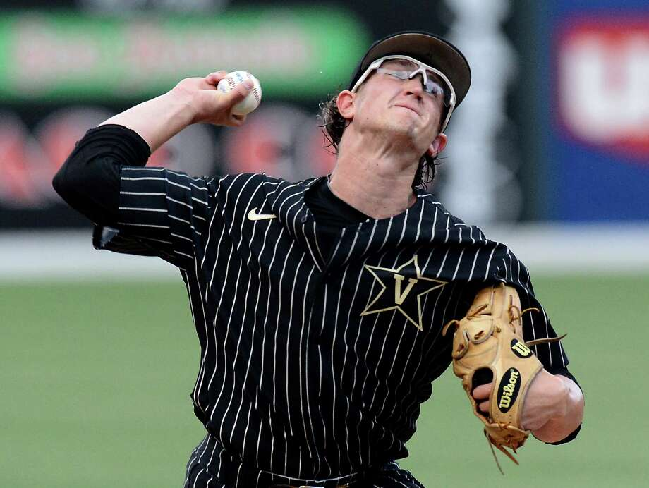 FILE - In this May 29, 2015, file photo, Vanderbilt pitcher Carson Fulmer throws against Lipscomb during the first inning of an NCAA college baseball regional tournament game in Nashville, Tenn. Illinois will face Vanderbilt's ace Carson Fulmer in the super regionals of the NCAA college baseball tournament on Saturday in Champaign, Ill.  (AP Photo/Mark Zaleski, File) Photo: Mark Zaleski, FRE / FR170793 AP