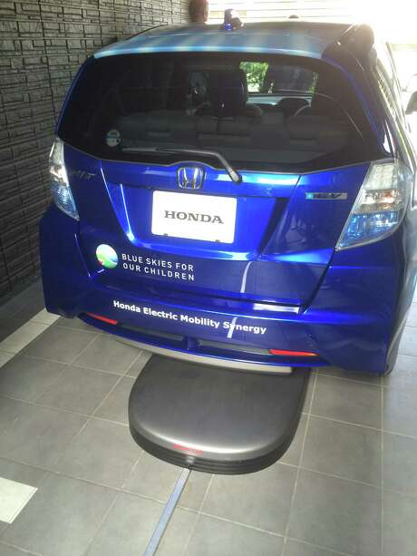 "Honda uses WiTricity's wireless charging technology with a Fit EV at the company's demonstration ""Smart Home"" in Saitama, Japan. Photo: WiTricity / ONLINE_YES"