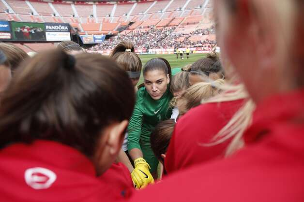 Goalkeeper Hope Solo #10 (C) of the U.S. Women's National Team stand in a huddle with teammate before her international friendly match against New Zealand on October 27, 2013 at Candlestick Park in San Francisco, California. The United States defeated New Zealand 4-1. Photo: Stephen Lam, Getty Images