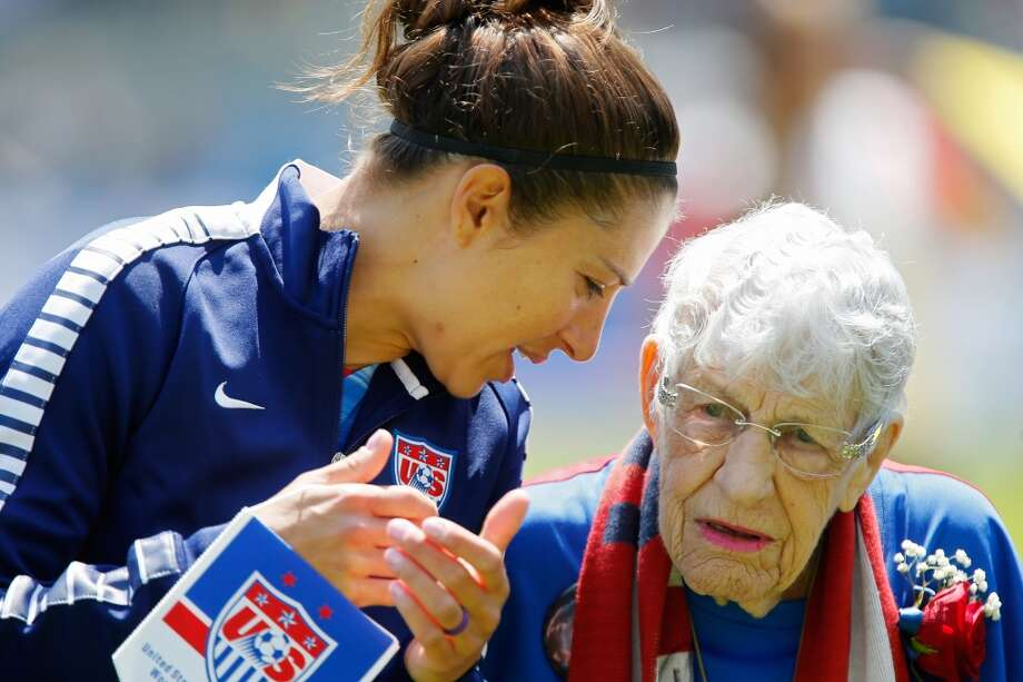 Carli Lloyd of the United States talks with Hope Solo's grandmother, Alice Shaw, during introductions on Mother's Day before a friendly match against Ireland on Mother's Day, May 10, 2015 at Avaya Stadium in San Jose, California. The U.S. won 3-0.