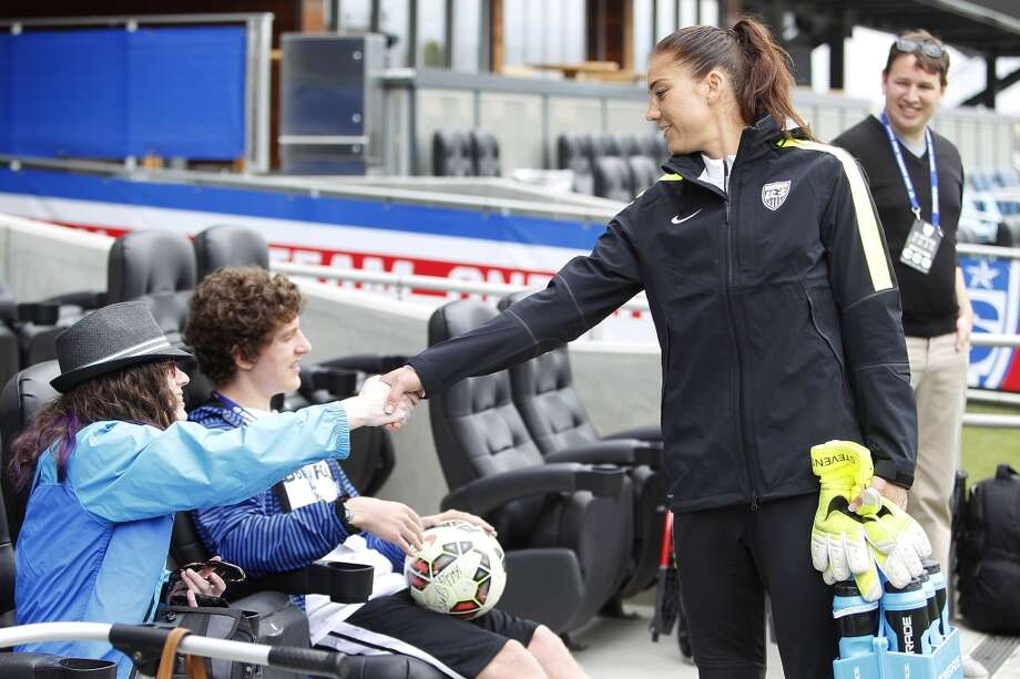 Goalkeeper Hope Solo of the United States says hello to a couple fans during practice on May 9, 2015 before an international friendly match against Ireland at Avaya Stadium in San Jose, California.  The U.S. won 3-0. Photo: Brian Bahr, Getty Images