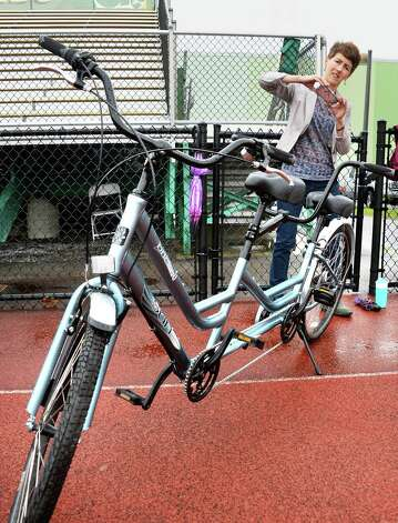 """Deborah Czech takes a photo of a tandem bikes during a media outing  for the Saratoga Springs Lions """"Camp Abilities Saratoga"""" at Skidmore College Friday June 5, 2015 in Saratoga Springs, NY.  (John Carl D'Annibale / Times Union) Photo: John Carl D'Annibale / 00032100A"""
