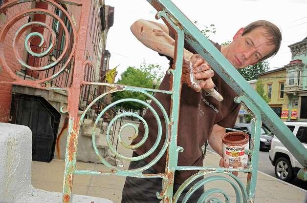 Handyman Steven Gibbs of Albany paints the metal railings in front of Romeo's Gifts on Lark St. on Friday, June 5, 2015 in Albany, N.Y.  (Lori Van Buren / Times Union) Photo: Lori Van Buren