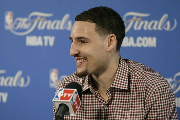 Golden State Warriors guard Klay Thompson smiles at a news conference after Game 1 of basketball's NBA Finals against the Cleveland Cavaliers in Oakland, Calif., Thursday, June 4, 2015. The Warriors won 108-100. (AP Photo/Ben Margot)