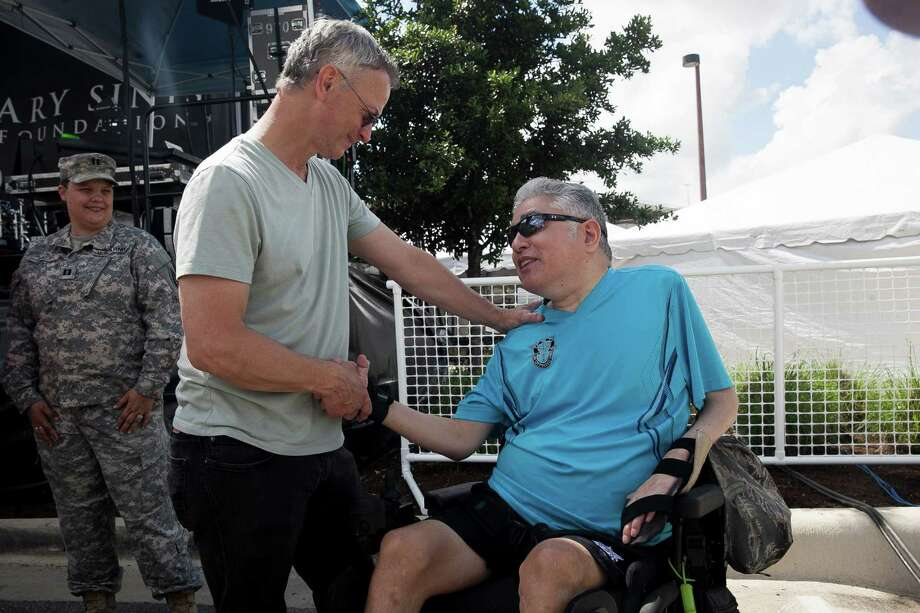 "Gary Sinise greets Daniel Castillo, U.S. Army disabled veteran, during Sinise's annual visit to San Antonio Military Medical Center Friday June 5, 2015. Castillo told Sinise, ""I am the original Lt. Dan!"" Photo: / / Julysa Sosa For the San Antonio Express-News"
