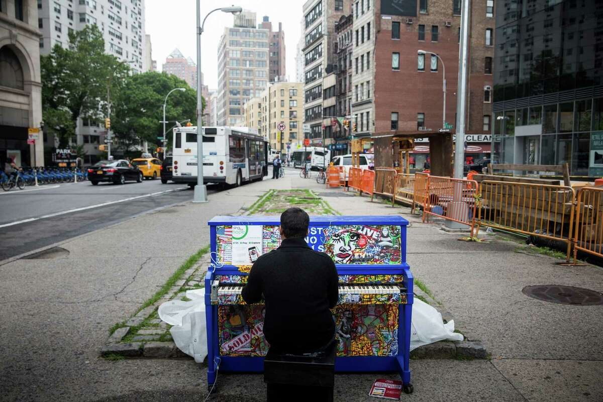 NEW YORK, NY - JUNE 05: Randy Naraine, a network engineer at J. Crew, stops and plays a piano outside the Astor Place subway stop near his work on June 5, 2015 in New York City. The