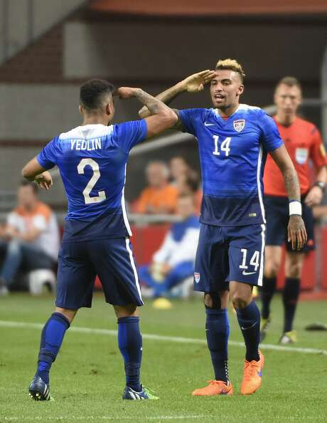 Danny Williams, right, salutes after scoring the tying goal for the Americans on Friday in Amsterdam. Photo: JOHN THYS, Stringer / AFP