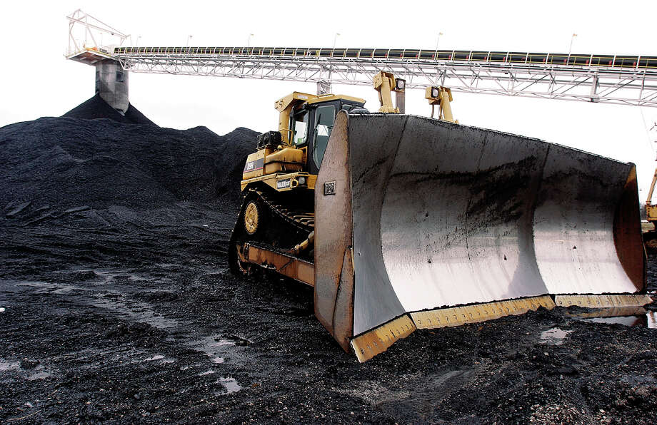 A dozer awaits work at Peabody Energy's Gateway Coal Mine near Coulterville, Ill. Peabody  recently listed the divestment campaign among  risk factors affecting its business. Photo: Associated Press File Photo / AP
