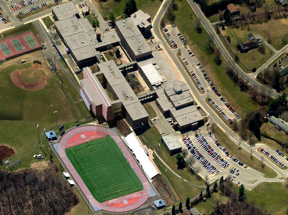 This aerial view of Danbury High School has been altered to include the proposed freshman academy wing adjacent to the football field. Photo: Contributed Photo / The News-Times Contributed