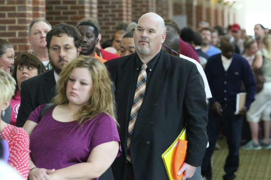 David Dunn from Chickamauga, Ga., center, stands in line with hundreds of other job seekers for a job fair this spring in Ringgold, Ga. The government reported Friday that U.S. employers added 280,000 jobs in May. Photo: Dan Henry, MBI / Chattanooga Times Free Press