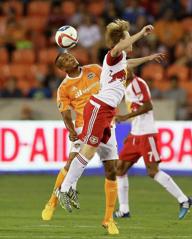 Houston Dynamo midfielder Ricardo Clark (13) heads the ball away from New York Red Bulls midfielder Dax McCarty (11) in the first half during a MLS soccer game on Friday, June 5, 2015 in Houston. (Bob Levey/For The Chronicle) Photo: Bob Levey, Photographer / ©2015 Bob Levey