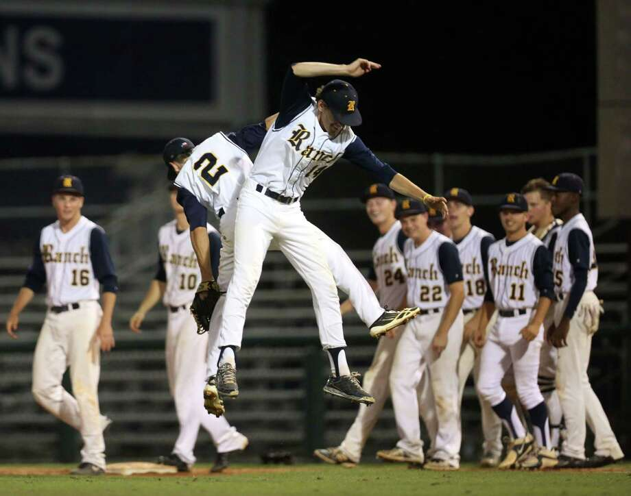 Cypress Ranch's Brent Hebert and Eric Alborn celebrate after winning game 2 of the Class 6A Region 3 Finals at Reckling Park Friday, June 5, 2015, in Houston. ( Jon Shapley / Houston Chronicle ) Photo: Jon Shapley, Staff / © 2015 Houston Chronicle