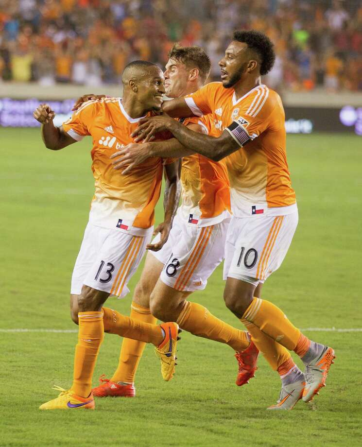 Houston Dynamo midfielder Ricardo Clark (13) is congratulated by forward Giles Barnes (10) and defender David Horst (18) after scoring in the second half during a MLS soccer game on Friday, June 5, 2015 in Houston. (Bob Levey/For The Chronicle) Photo: Bob Levey, Houston Chronicle / ©2015 Bob Levey