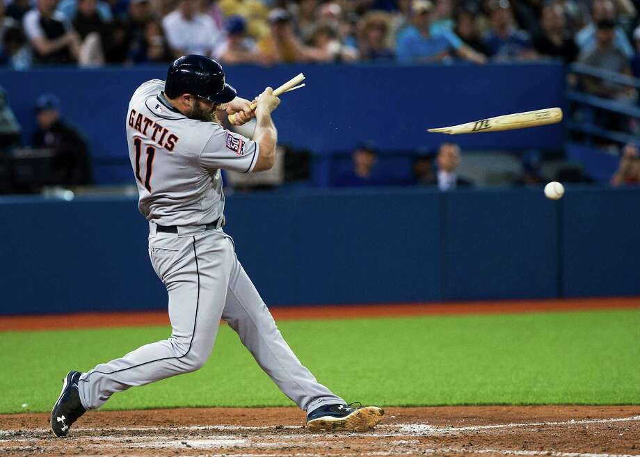 Astros designated hitter Evan Gattis, who went 0-for-4, breaks his bat as he grounds out to Blue Jays pitcher Aaron Sanchez in the seventh inning of Friday night's 6-2 loss at Toronto Photo: Aaron Vincent Elkaim, SUB / CP
