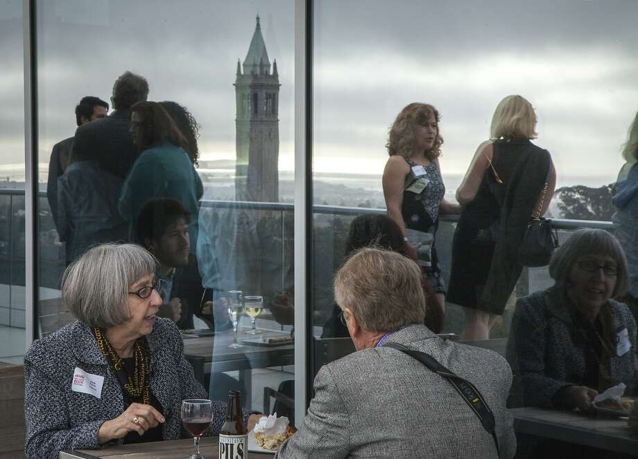 Guests dine and chat during the opening reception of the Bay Area Book Festival, held at the University Club on the top floor of Memorial Stadium in Berkeley. Photo: Santiago Mejia, Special To The Chronicle