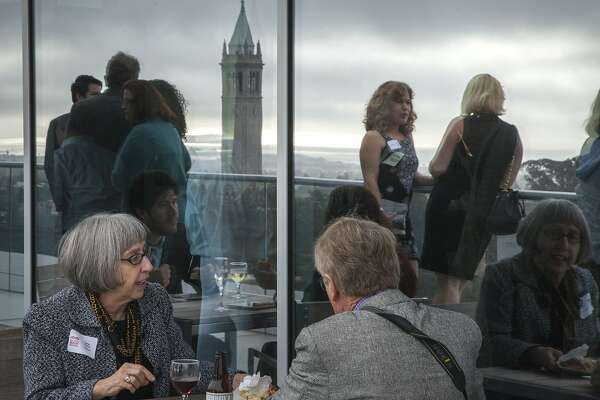 Guests dine and chat during the opening reception of the Bay Area Book Festival held at the top floor of the California Memorial Stadium, Friday, June 5, 2015, in Berkeley, Calif.