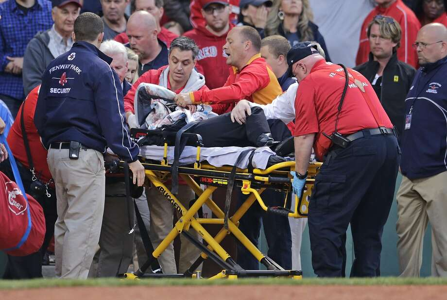 In a frightening incident in June, a fan in Boston had to be taken off after being hit in the head by part of the bat of the A's Brett Lawrie. Photo: Charles Krupa, Associated Press