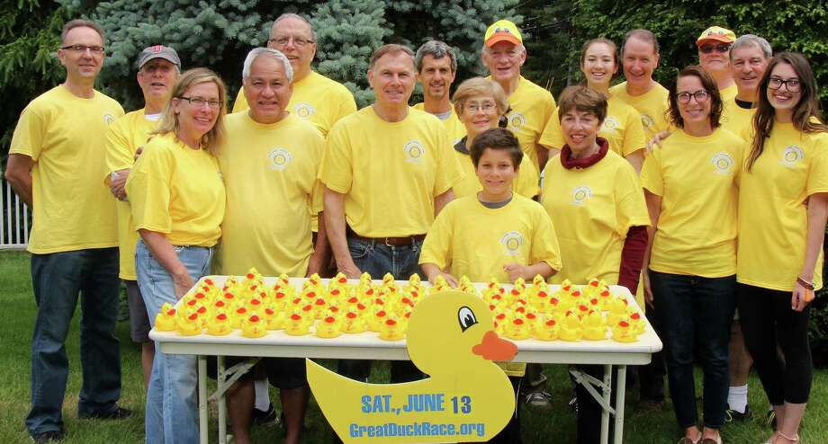 "Members of the Westport Sunrise Rotary Club promote their annual ""Great Duck Race"" on the Saugatuck River, a charity fundraiser set June 13 from 9 a.m. to 3 p.m. on Jesup Green. Photo: Contributed Photo / Contributed Photo / Westport News"