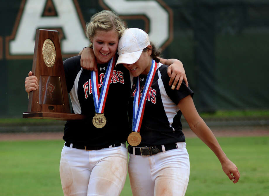 Huffman senior catcher Loren Dempsey, left, and junior centerfielder Maggie McCloskey share a quite momemt with their team's trophy after the Falcon's 6-4 win over the Needville Lady Jays in their Class 4A UIL State Softball Championship finals matchup at McCombs Field in Austin on Saturday, June 6, 2015. (Photo by Jerry Baker/Freelance) Photo: Jerry Baker, For The Chronicle