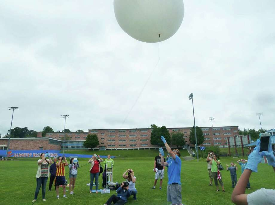 Eighth grade students from West Side Middle School Academy launched two weather balloons from a field at Danbury High School on Saturday, June 6, 2015, in Danbury, Conn. The STEM Science, Technology, Engineering and Math education, students coordinated the process of building, funding, and launching the balloons. The GPS tracking device went up with the weather balloon so it could be tracked and retrieved. Photo: Contributed Photo / The News-Times Contributed