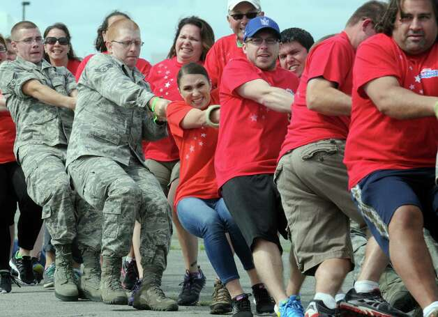 Members of the Price Chopper team try their hands at pulling a C130 Hercules from the 109th Air National Guard Base during the MVP Health Care Corporate Challenge Airplane Pull at the Empire State Aerosciences Museum on Saturday June 6, 2015 in Glenville , N.Y.  (Michael P. Farrell/Times Union) Photo: Michael P. Farrell / 00031854A