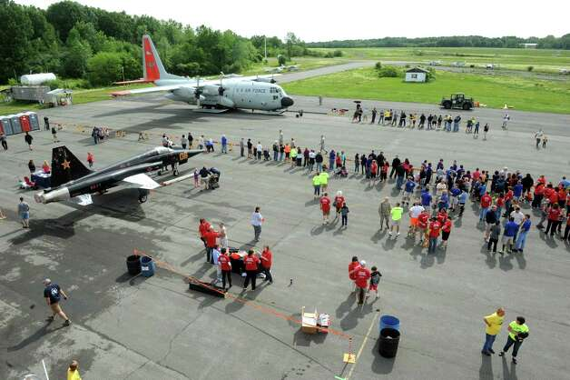Members of the Foggs Automotive team try their hands at pulling a C130 Hercules from the 109th Air National Guard Base during the MVP Health Care Corporate Challenge Airplane Pull at the Empire State Aerosciences Museum on Saturday June 6, 2015 in Glenville , N.Y.  (Michael P. Farrell/Times Union) Photo: Michael P. Farrell / 00032154A