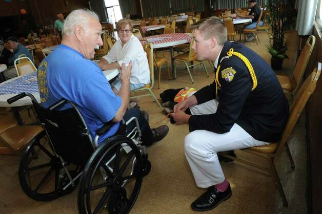 CBA Cadet Austin Nevins, left, talks with Vietnam Army Veteran Jerry Barr of Glenville during a 71st anniversary of D-Day welcome to all to honor those who serve and served at Colonie Elks Lodge on Saturday June 6, 2015 in Colonie , N.Y.  (Michael P. Farrell/Times Union) Photo: Michael P. Farrell / 00032102A