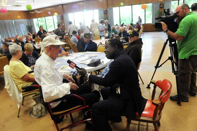 World War II Army Ranger Veteran Bill Warren of Chatham is interviewed by WNYT anchor Dan Bazile during a 71st anniversary of D-Day welcome to all to honor those who serve and served at Colonie Elks Lodge on Saturday June 6, 2015 in Colonie , N.Y.  (Michael P. Farrell/Times Union) Photo: Michael P. Farrell / 00032102A