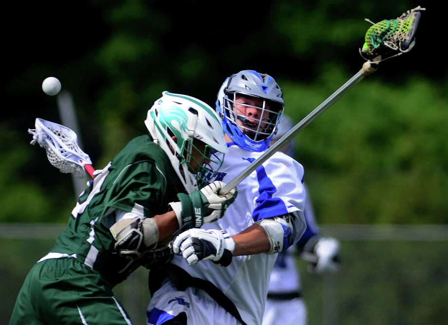 New Milford's Caleb Anderson, left, body checks Darien's Geoffrey Parnon, during Class L lacrosse quarterfinals action in Darien, Conn., on Saturday June 6, 2015. Anderson received a penalty for the hit. Photo: Christian Abraham, Staff Photographer / Connecticut Post