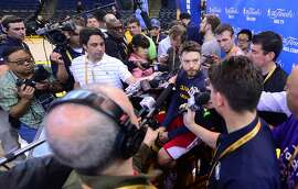 Matthew Dellavedova of the Cleveland Cavaliers takes questions from the media on June 6, 2015 in Oakland, California, a day before Cleveland Cavaliers play the Golden State Warriors in Game 2 of the 2015 NBA finals.  AFP PHOTO / FREDERIC J. BROWNFREDERIC J. BROWN/AFP/Getty Images
