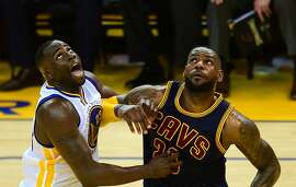 Draymond Green (L) of the Golden State Warriors and LeBron James (R) of the Cleveland Cavaliers vie for the rebound during Game 1 of the 2015 NBA Finals in Oakland, California on June 4, 2015. The Warriors defeated the Cavaliers 108-100 in overtime.  AFP PHOTO / FREDERIC J. BROWNFREDERIC J. BROWN/AFP/Getty Images