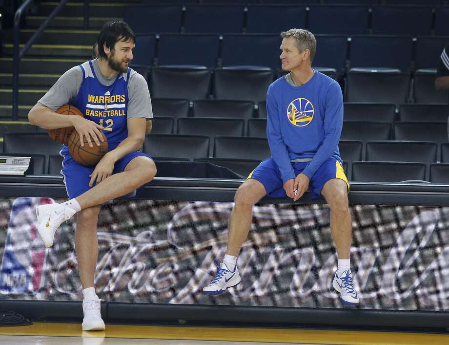 Andrew Bogut chats with coach Steve Kerr during the Golden State Warriors practice at Oracle Arena in Oakland, Calif. on Saturday, June 6, 2015. Photo: Paul Chinn, The Chronicle