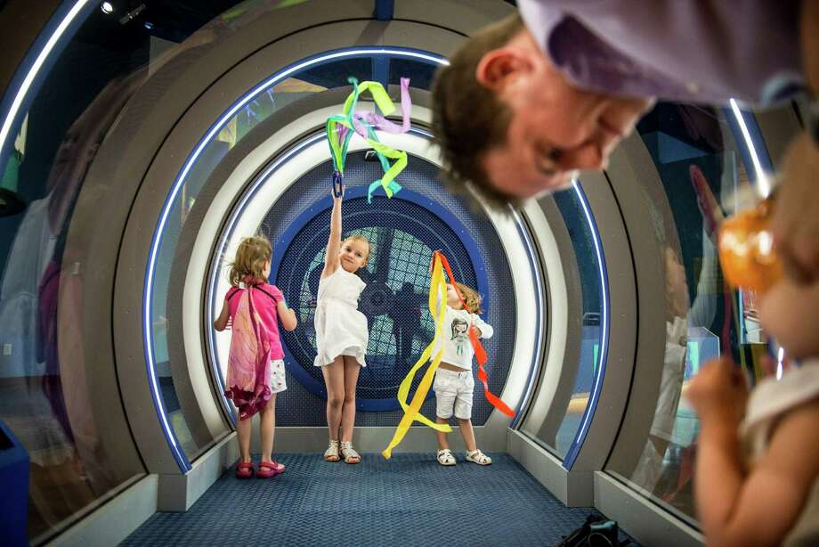Children play in the Wind Tunnel during the DoSeum's grand opening in San Antonio on Saturday, June 6, 2015. Photo: Matthew Busch, For San Antonio Express-News / For San Antonio Express-News / © Matthew Busch