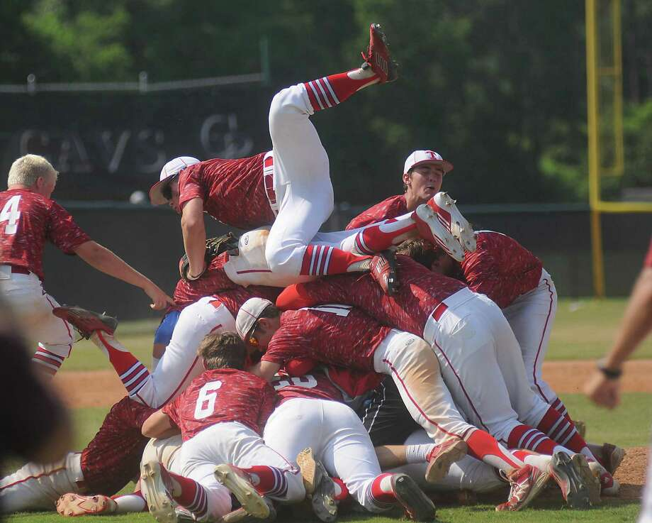 The Tomball Cougars celebrate after defeating Tomball Memorial during Game 3 of the Class 5A Region III baseball final at College Park High School in The Woodlands Saturday June 06, 2015. (Dave Rossman photo) Photo: Dave Rossman, For The Chronicle / Freelalnce