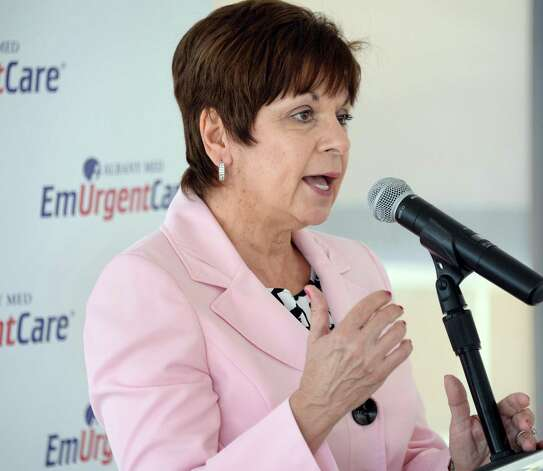 Town of Colonie supervisor Paula Mahan speaks at the opening of the new Albany Med EmUrgentCare, a walk-in urgent medical facility, in the Hannaford Plaza on Wolf Road Friday May 29, 2015 in Colonie, NY. Some of her most prolific poltical contributors have sought planning board approvals from the town.   (John Carl D'Annibale / Times Union) Photo: John Carl D'Annibale / 00032038A
