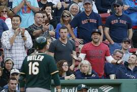 Oakland Athletics' Billy Butler (16) walks to the dug out after striking out during the eighth inning of a baseball game against the Boston Red Sox in Boston, Saturday, June 6, 2015. (AP Photo/Michael Dwyer)