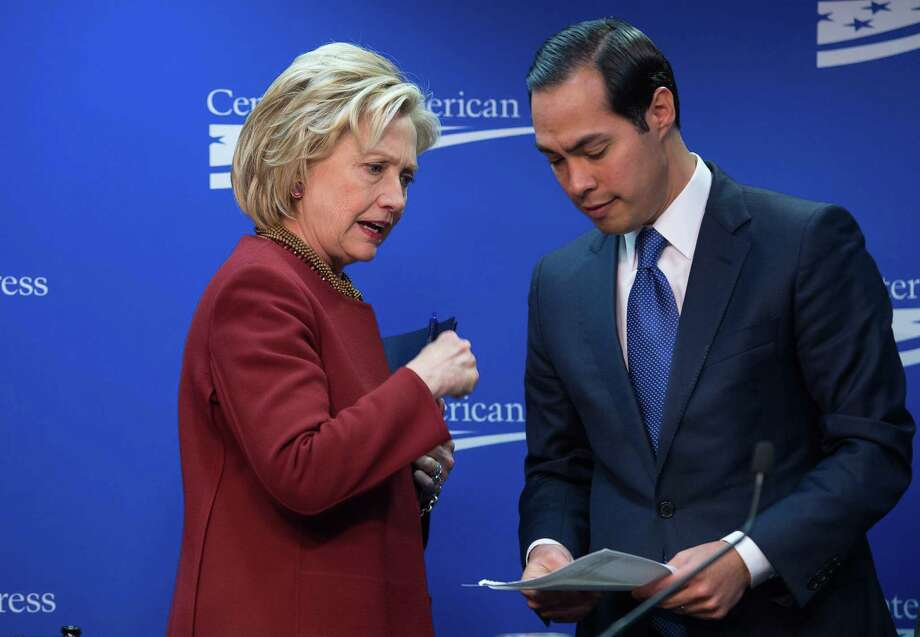 "Former US Secretary of State Hillary Clinton talks with Housing and Urban Development Secretary Julian Castro after taking part in a discussion on ""our nation's urban centers,"" and ""challenges from housing and transportation to education and workforce accessibility"" at the Center for American Progress (CAP) in Washington, DC, on March 23, 2015. AFP PHOTO/NICHOLAS KAMMNICHOLAS KAMM/AFP/Getty Images Photo: Getty Images File Photo / Nicholas Kamm/AFP"