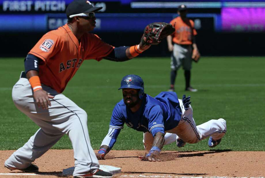 TORONTO, CANADA - JUNE 6: Jose Reyes #7 of the Toronto Blue Jays steals third base in the fourth inning during MLB game action against the Houston Astros on June 6, 2015 at Rogers Centre in Toronto, Ontario, Canada. (Photo by Tom Szczerbowski/Getty Images) Photo: Tom Szczerbowski, Stringer / 2015 Getty Images
