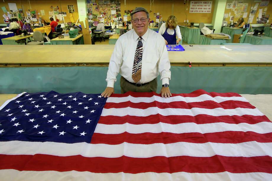 Pete Van de Putte owns Dixie Flag Manufacturing Company and has run the business since 1980. His parents started the business in 1958 and their first job was for the Poteet Strawberry Festival. His wife, former state senator Leticia Van de Putte, is running for mayor of San Antonio and is facing incumbent Ivy Taylor in a 2015 runoff election. Photo: John Davenport, Staff / San Antonio Express-News / ©San Antonio Express-News/John Davenport