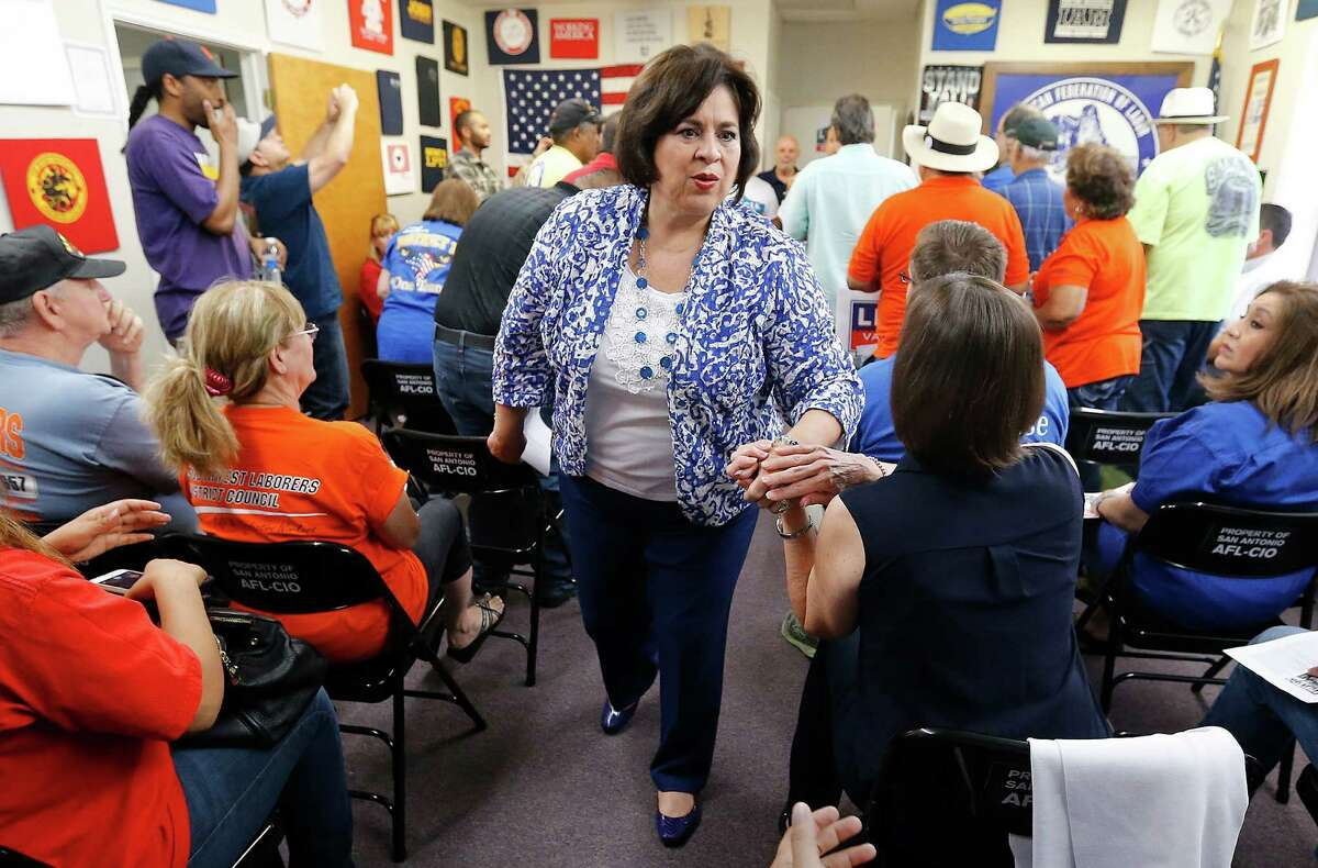 Mayoral candidate Leticia Van de Putte greets supporters at a rally at the local AFL-CIO offices on Saturday.