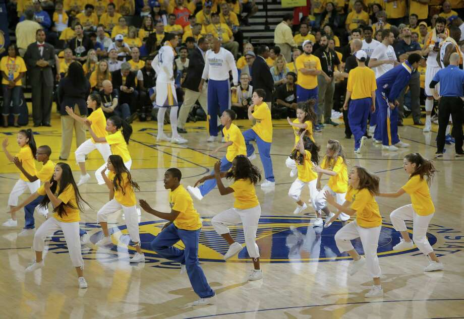 The Warriors Junior Jam Squad takes to the court to perform during a timeout as the Golden State Warriors take on the Cleveland Cavaliers in Game 1 of the NBA Finals at Oracle Arena. Photo: Michael Macor / Michael Macor / The Chronicle / ONLINE_YES