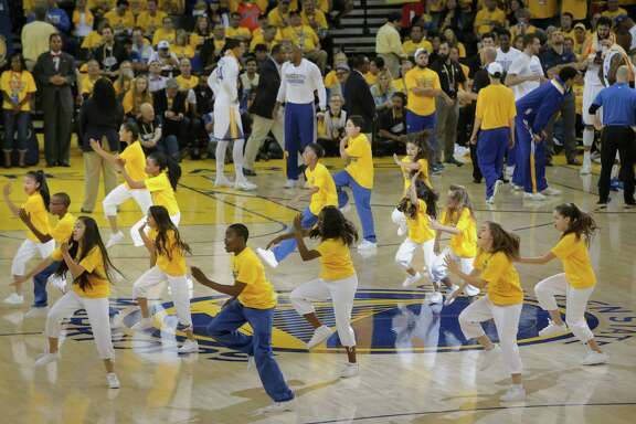 The Warriors Junior Jam Squad takes to the court to perform during a timeout as the Golden State Warriors take on the Cleveland Cavaliers in Game 1 of the NBA Finals at Oracle Arena.