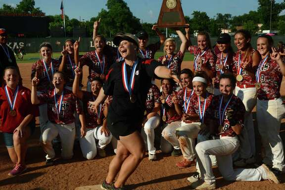 Katy asst. coach Meghan Brown, center, photo-bombs the Tiger's trophy photo after their 3-2 win over Lewisville in the Class 6A UIL State Softball Championship final at McCombs Field in Austin on Saturday, June 6, 2015. (Photo by Jerry Baker/Freelance)